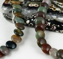 Mixed jasper necklace (Item JSGFN101) displayed on ocean jasper slab