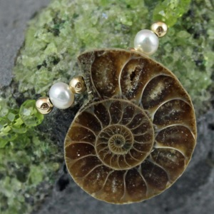 Fossil Ammonite with peridot, cultured pearls, and gold-filled. Item FAGFN103 Background of natural olivene crystals.